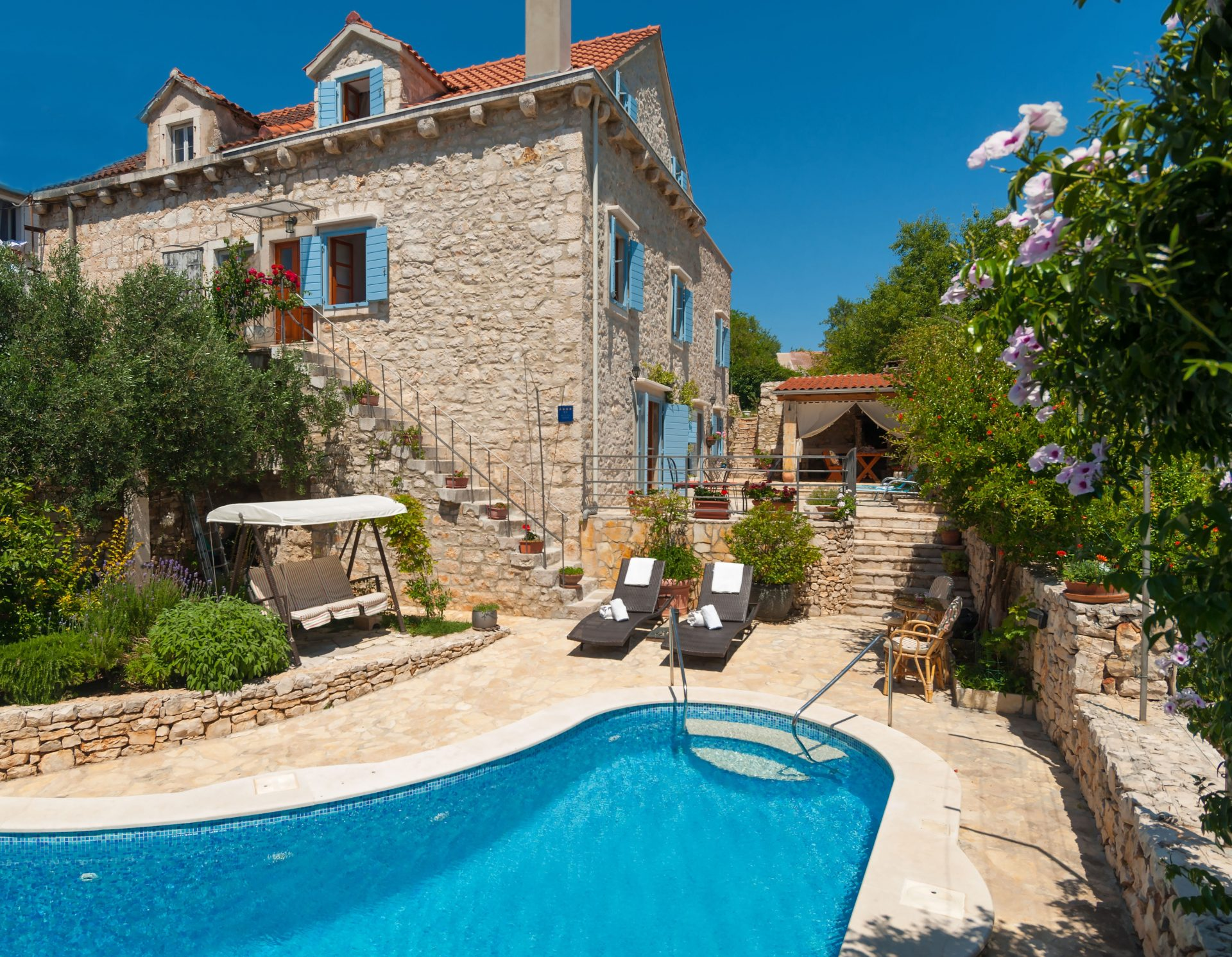 stone accommodation villa with pool