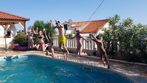 Children have fun at the swimming pool of villa Mir Vami - Brac, Croatia - Orvas Villas