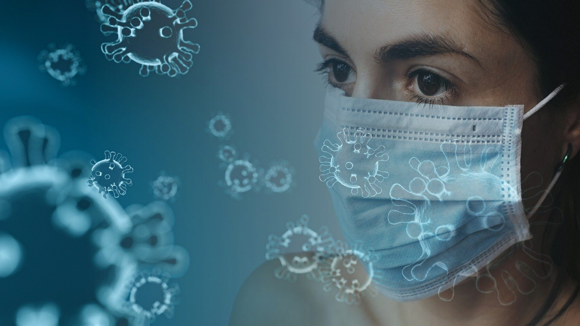 Coronavirus particles in the air and young woman wearing a medical mask