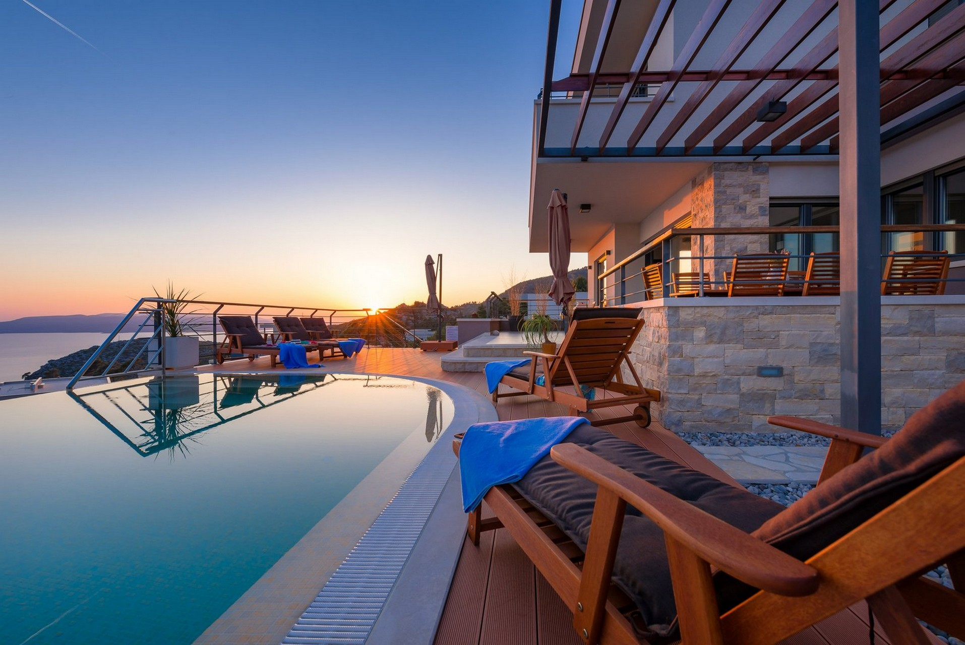sunset view from villa with pool